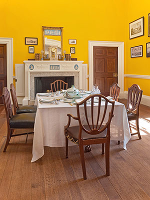 Dining Room looking southeast with restored <em>Chrome Yellow</em> paint
