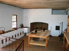 Monticello's Kitchen showing stew stove, work table, and hearth
