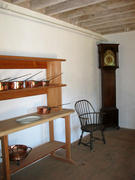 Kitchen showing shelves and reproduction of clock facing north